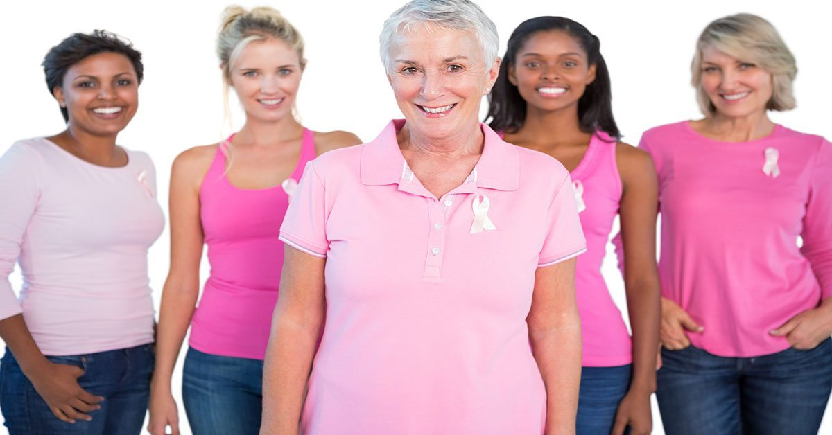 Women wearing pink shirts and breast cancer ribbons