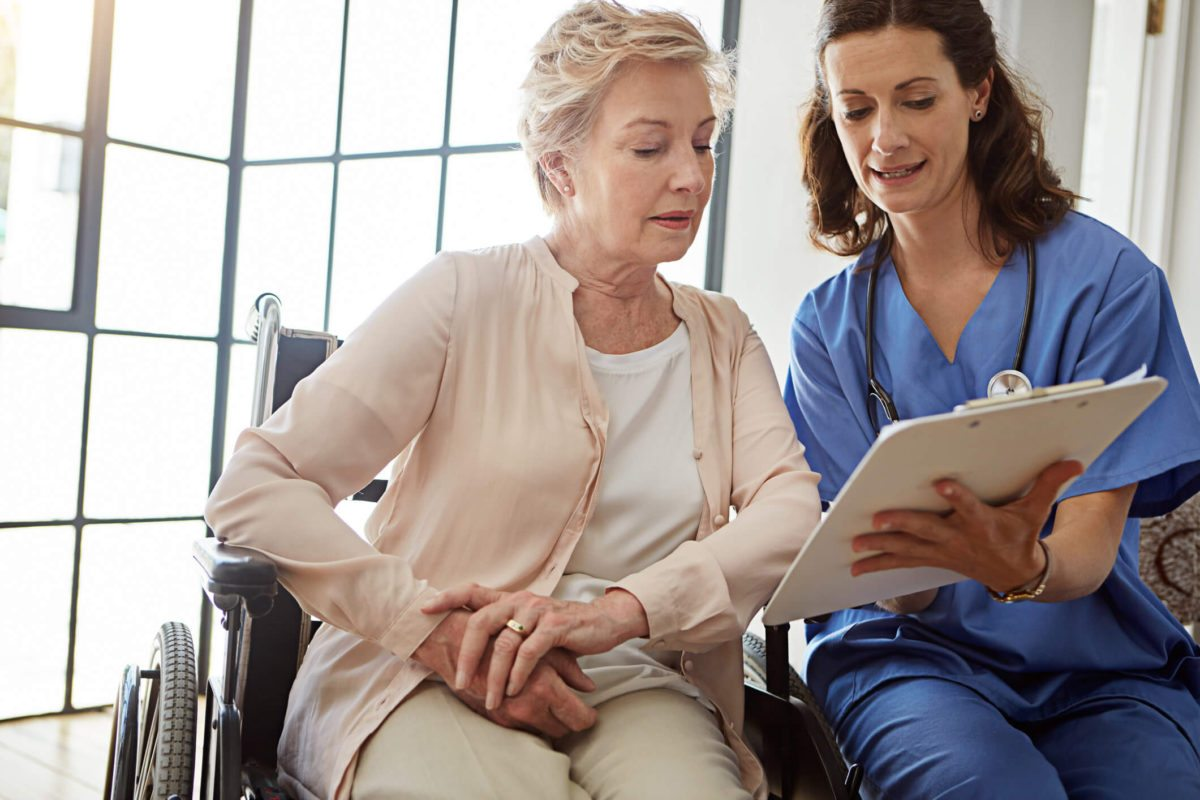 Nurse with older patient