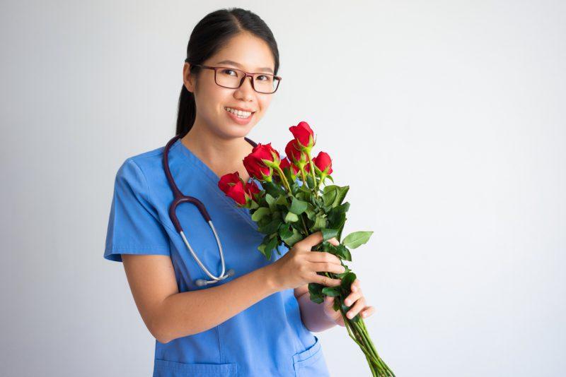 nurse holding flowers