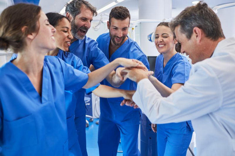 nurses putting hands together