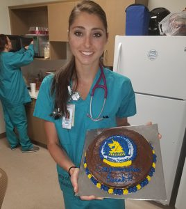 Sarah Sellers, RN, CRNA, with cake celebrating her 2nd place finish at Boston Marathon.
