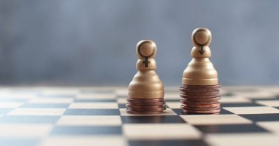 gender pay gap - Two chess pawns on top of a heap of coins with varying heights