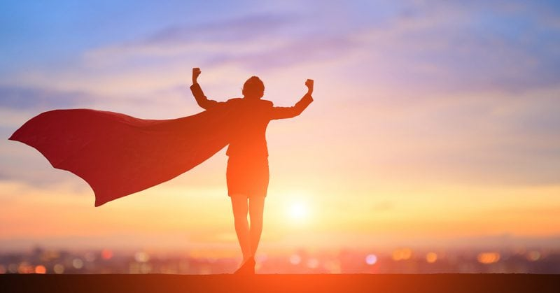 empowered nurse - silhouette of woman feeling strong with cape