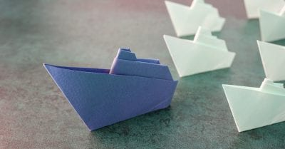 nurse manager - Origami paper ships, leadership concept, toning