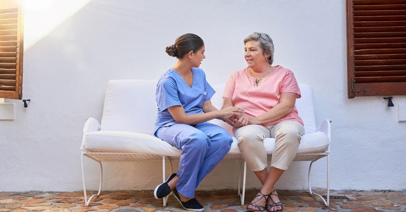 empathy - Shot of a caregiver chatting to a senior patient outside