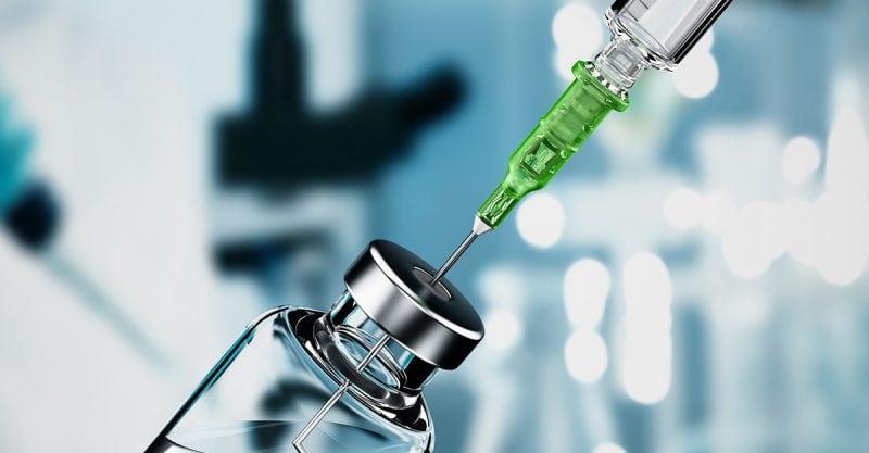ketamine - Syringe needle inside medicine bottle on laboratory tubes background