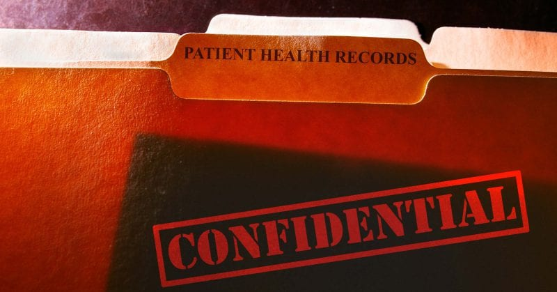 continuing nursing education - file folders with Patient Health Records label and Confidential stamp