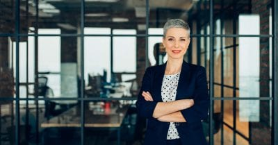 nurses on boards-Successful Young Businesswoman with arms crossed
