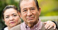 Spanish for nurses - Smiling, Caring, hispanic nurse and elderly senior patient in nursing home
