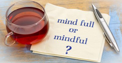 nurse stress - Mind full or mindful ? Inspirational handwriting on a napkin with a cup of tea