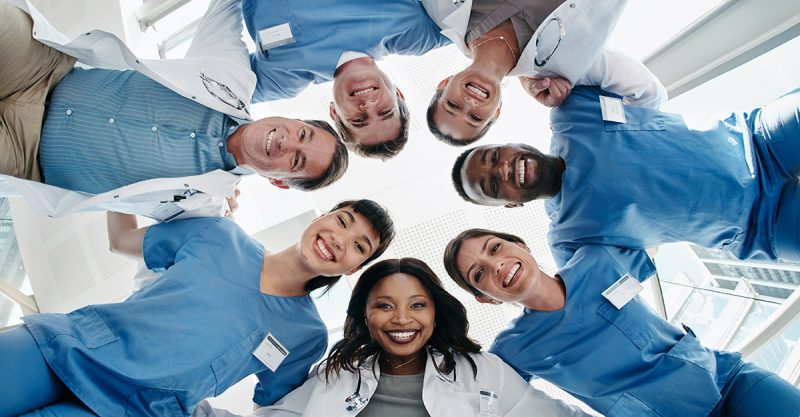 year of the nurse - Group of healthcare workers looking down at the camera