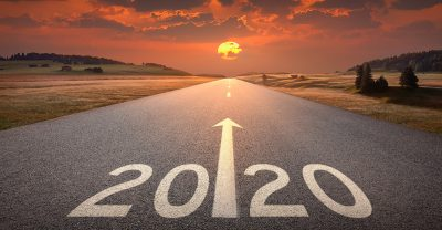 year of the nurse and midwife - Driving on idyllic open road against the setting sun forward to upcoming 2020 new year. Concept for success and future.