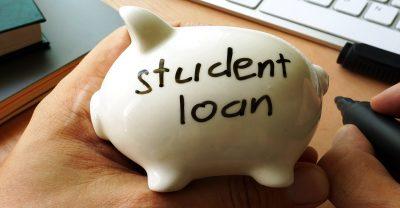 nursing student loans - Student loan written on a piggy bank.