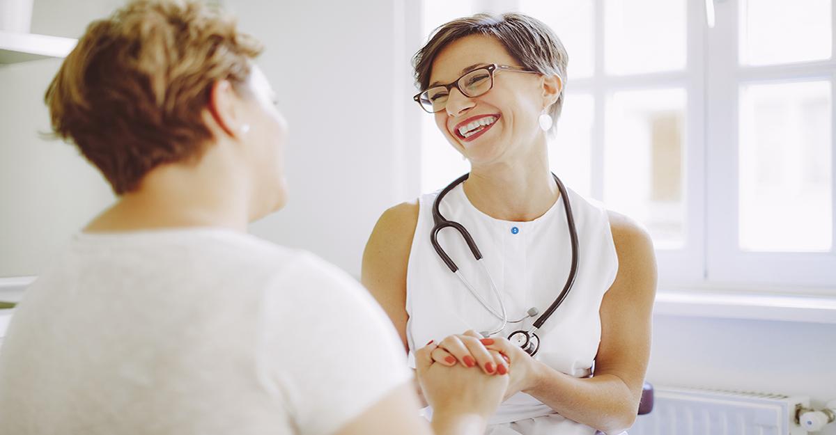 nurse coach conferring with patient